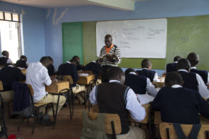 High school students listening to a teacher's lecture.